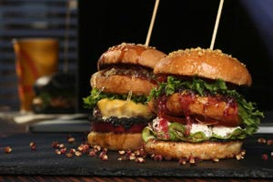 Gourmet Burgers Decked out in Many Delicious Ingredients